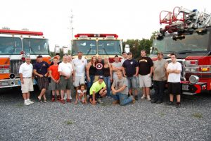 duty-crews-from-the-shippensburg-pa-fire-department-pose-with-the-fire-house-dolls-at-the-cvvfa-convention-picnic